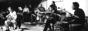 Chris with Oblomow,November 20, 1999, in Loenhout, Belgium. Photo by Patrick De Spiegelaere.  Dirk Vandewiele is at the drums on the far right.