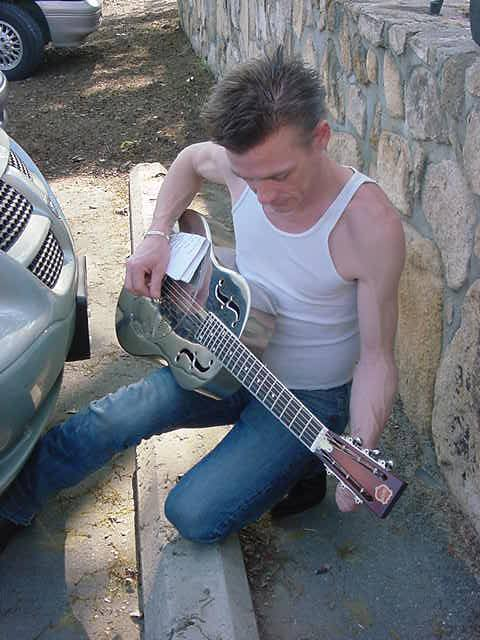 tuning his NEW guitar in Carboro NC - Fluffy